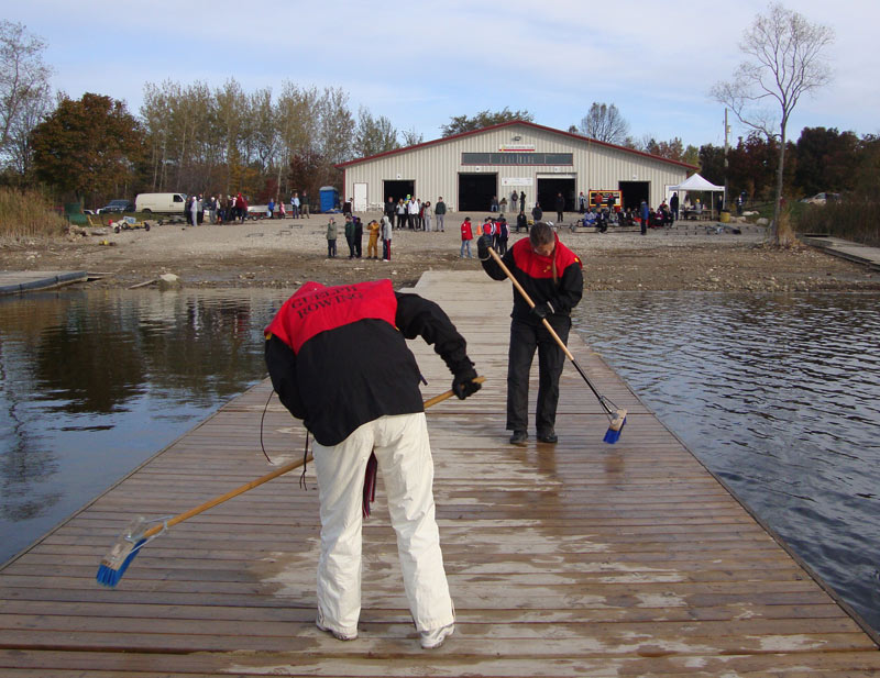 Volunteers sweeping the docks a the GRC